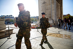 © Licensed to London News Pictures. 15/11/2015. Paris, France. French soldiers patrolling Arc de Triomphe in Paris, France following the Paris terror attacks on Sunday, 15 November 2015. Photo credit: Tolga Akmen/LNP
