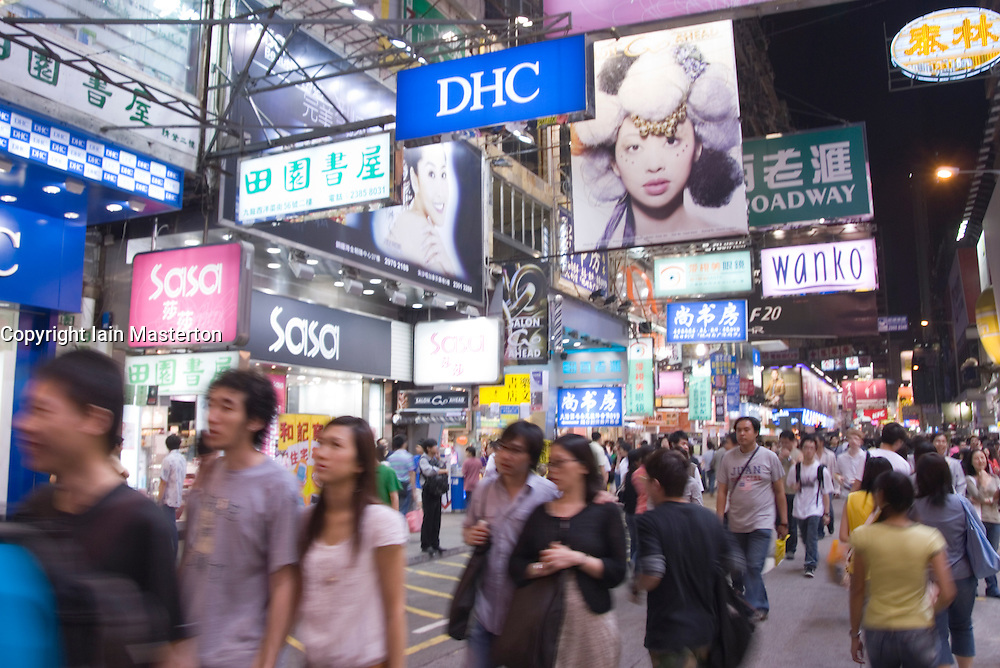 Busy street at night in shopping district of Mongkok in Kowloon Hong Kong
