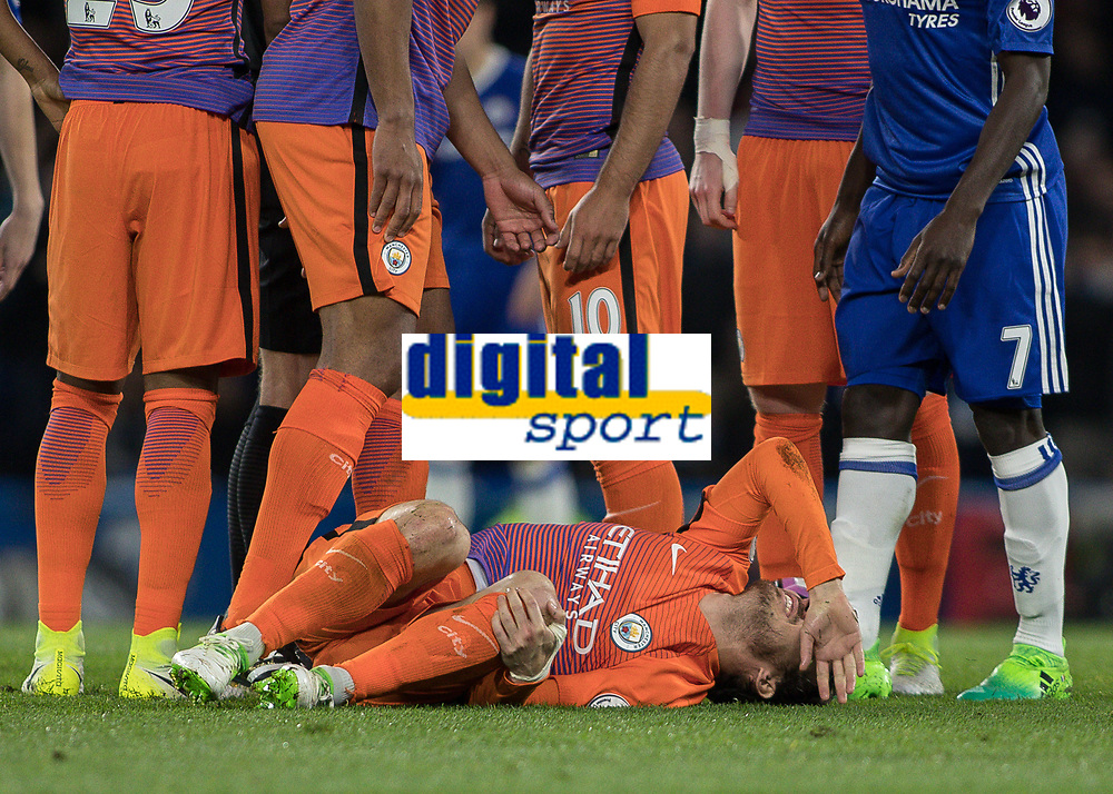 Football - 2016 / 2017 Premier League - Chelsea vs. Manchester City<br /> <br /> David Silva of Manchester City shows the pain after a challenge from Ngolo Kante of Chelsea at Stamford Bridge.<br /> <br /> COLORSPORT/DANIEL BEARHAM