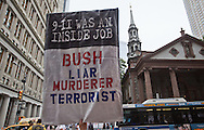 Anti Bush sign at a rally to find out the truth about September 11th held on 10th anniversary of the 9/11 attacks on the World Trade Center towers across from St Paul's Chapel near ground zero. The 9/11 Truth Movement started in 2006 by family members who want answers about what happened on 9/11and have staged rallies at Ground Zero every year on 9/11.