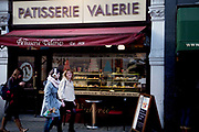 Outside the original Patisserie Valerie in Soho central London. The was the first store on Old Compton Street, that has now become a very successful chain of patisseries. <br /> <br /> Patisserie Valerie was originally conceived in Frith Street Soho in 1926 by Madam Valerie. She came to London on a mission to introduce fine Continental Patisserie to the English. It was an instant success.<br /> <br /> During the Second World War the Frith Street premises were bombed by the Luftwaffe and Madam Valerie subsequently set up shop around the corner in Old Compton Street where her legacy continues to this day in our Soho branch.<br /> <br /> The unique café-atmosphere includes the decor left over from the 1950's epitomised by the now famous Toulouse-Lautrec style cartoons by Terroni.