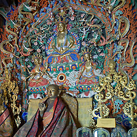Buddha figures in Choijinlam Temple, a rare, remaining Tibetan Buddhist sanctuary in Ulaanbaator, Mongolia. During the country's Soviet occupation, religion was discouraged and thousands of monks and lamas were executed.  The religion is making a resurgence after independence.