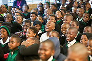 "Children from Ithute primary school in the Alexandra Township, Johannesburg, South Africa, watch a performance of the 'About Us"", an AREPP: Theatre for Life production providing interactive social life skills education to school children through theatre productions. They are based in Johannesburg, South Africa and are on tour for 3 months doing performances everyday at schools across the country."