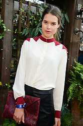 SARAH ANN MACKLIN attending the Warner Bros. & Esquire Summer Party held at Shoreditch House, Ebor Street, London E1 on 18th July 2013.