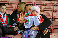 A young welsh fan ahead of the Friendly European Championship warm up match between Wales and Trinidad and Tobago at the Racecourse Ground, Wrexham, United Kingdom on 20 March 2019.