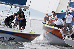 Paolo Cian narrowly avoids fouling Torvar Mirsky on day 3 of Korea Match Cup 2010. World Match Racing Tour. Gyeonggi, Korea. 11 June 2010. Photo: Gareth Cooke/Subzero Images