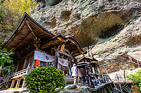 Iwaya-ji means, Rock Cave Temple and is hard place to get to. Ancient folklore tells us that a mysterious shaman priestess led Kukai here This lady-hermit was named Hokke-Sennin. The home of the priest is built against a cliff that rises straight up into the sky.  Kukai made two statues of Fudou, one of them from stone, and placed this stone Fudou inside the cave. By placing the Fudou inside the cave the entire mountain becomes a sacred place. This is truly a spectacular place to visit and explore. The path on the way up is lined with moss covered statues and trees. Iwayaji is the place where Kobo Daishi trained himself.  Iwaya-ji is temple number 45 on the Shikoku 88 Pilgrimage Trail which is traditionally completed on foot taking up some 40 days to complete as the full course is approximately 1200 km.