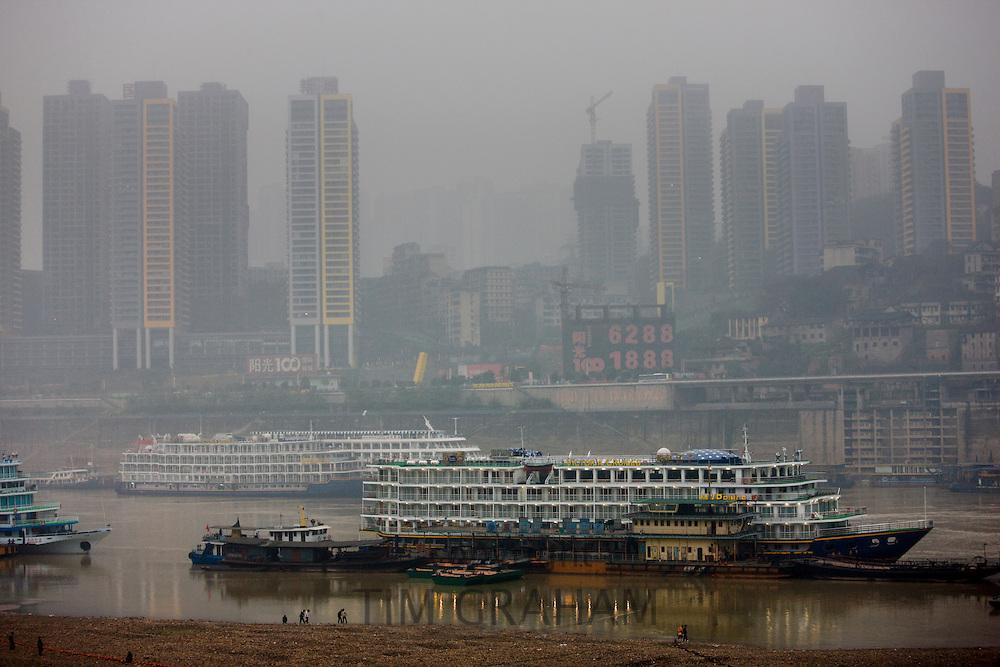 Pleasure cruisers from Victoria Line awaiting Western passengers for Yangtze River cruise, Chongqing, China