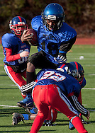 Newburgh, New York - A Middletown runner is tackled by a Goshen defender in the Orange County Youth Football League Division II Super Bowl at Newburgh Free Academy on Nov. 22, 2014.