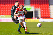 James Coppinger of Doncaster Rovers (26) and Ryan Edwards of Plymouth Argyle (5) in action during the EFL Sky Bet League 1 match between Doncaster Rovers and Plymouth Argyle at the Keepmoat Stadium, Doncaster, England on 13 April 2019.
