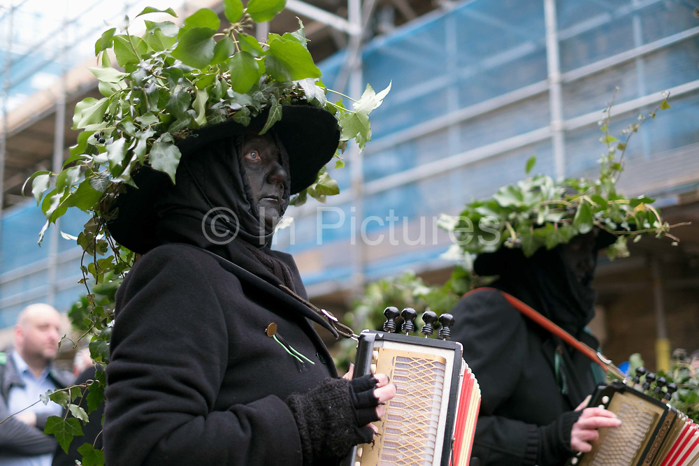 Old Glory Molly musicians at the Straw Bear Festival in Whittlesey near Peterborough, United Kingdom on 13th January 2018. The traditional event was revived in 1980 and features a Straw Bear and its children being led through the streets of Whittlesey. The bear dances, while musicians break off into groups around the town square to perform with many different Morris, Molly, Sword, Mummer and Appalachian dancing teams