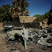 January 21, 2013 - Diabaly, Mali: A local child stands by destroyed islamic militants' armoured vehicles in central Diabaly, a day after Mali government troops regain control of the city. Diabaly was under islamist militants control since the 14th of January.<br /> <br /> Several insurgent groups have been fighting a campaign against the Malian government for independence or greater autonomy for northern Mali, an area known as Azawad. The National Movement for the Liberation of Azawad (MNLA), an organisation fighting to make Azawad an independent homeland for the Tuareg people, had taken control of the region by April 2012.<br /> <br /> The Malian government pledge to the French army to help the national troops to stop the rebellion advance towards the capital Bamako. The french troops started aerial attacks on rebel positions in the centre of the country and deployed several hundred special forces men to counter attack the advance on the ground. (Paulo Nunes dos Santos)