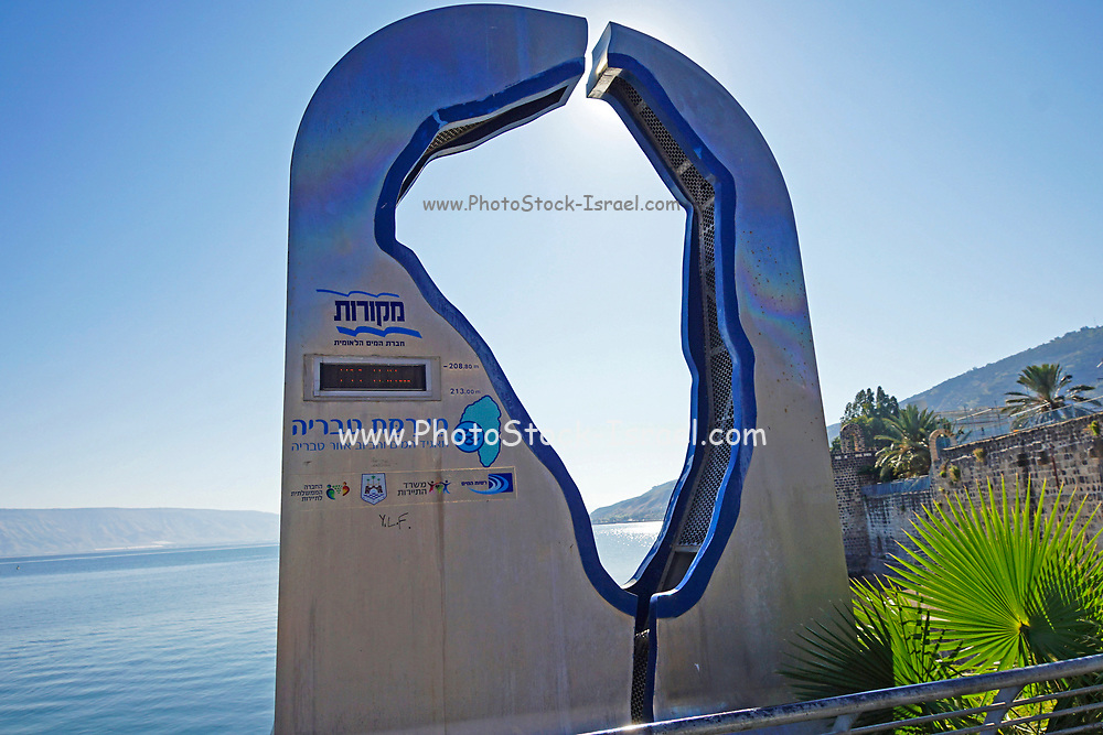 The Promenade along the Sea of Galilee at Tiberias, Israel. A sign displays the water level in Lake Tiberias (Israel's only source of water)