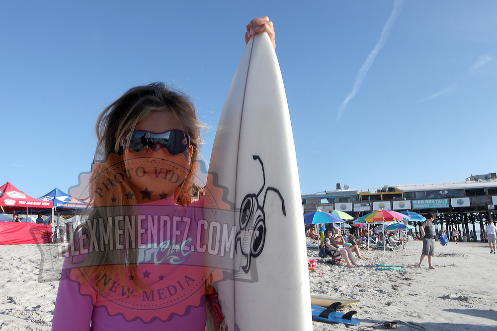 A young surfer is seen at the 28th annual National Kidney Foundation, Rich Salick Pro/Am surf festival takes place at the the Cocoa Beach pier on Saturday,  September 2, 2013 in Cocoa Beach, Florida. This event raises thousands of dollars for people with kidney disease and also benefits the services of the NKF of Florida. (AP Photo/Alex Menendez)