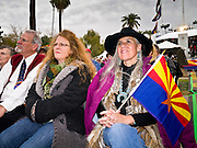 14 FEBRUARY 2012 - PHOENIX, AZ:   People with Arizona flags during the centennial celebration at the State Capitol in Phoenix, Feb 14. Arizona's statehood day is February 14 and this year Arizona marked 100 years of statehood. It was the last state in the 48 contiguous United States.   PHOTO BY JACK KURTZ