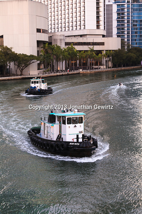 Two tugs cruise west on the Miami River near 3rd Avenue in downtown Miami, Florida WATERMARKS WILL NOT APPEAR ON PRINTS OR LICENSED IMAGES.