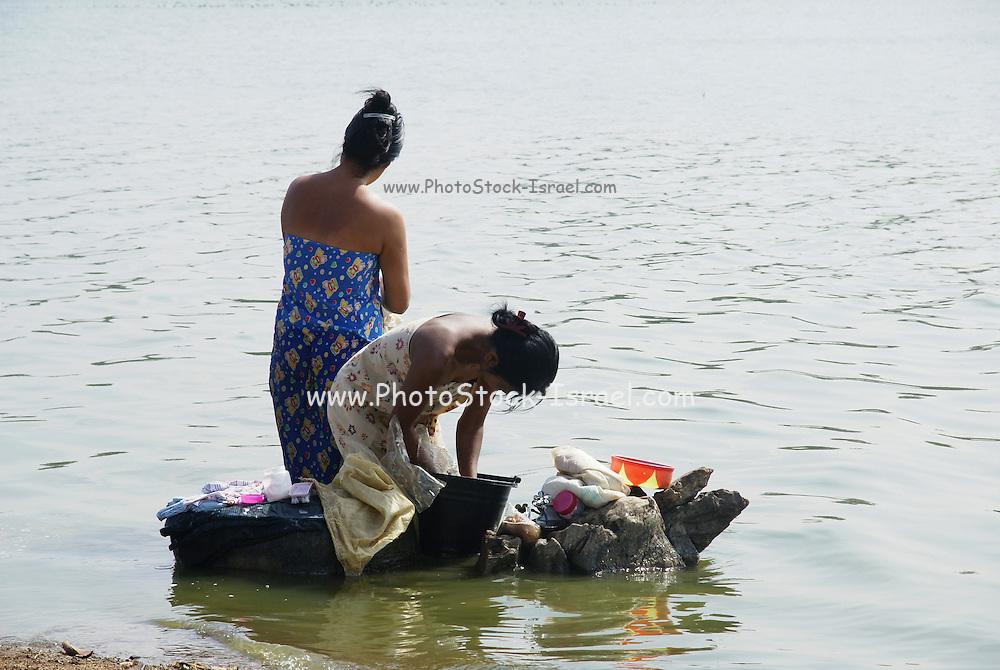 Myanmar, Shan State, Pindaya woman wash clothes in the lake
