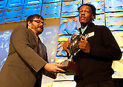 Lancaster defensive end Daeshon Hall is presented the SportsDayHS defensive player of the year award by Corbett Smith at SportsDayHS' third-annual football Heroes Banquet at the Omni Hotel on Thursday, January 17, 2013 in Dallas. (Cooper Neil/The Dallas Morning News)
