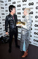 Johnny Marr with the Lifetime Achievement Award and Rose McGowan with the Inspiration Award in the press room at the GQ Men of the Year Awards 2018 in Association with Hugo Boss held at The Tate Modern in London.