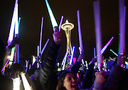 "Several hundred Star Wars fans gather underneath the Space Needle Saturday night to wage a lightsaber battle. The light saber battle coincided with the opening of ""Star Wars: The Force Awakens.""<br />