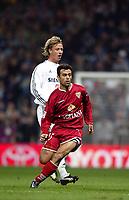 4/2/2004 Madrid, Spain.<br />Copa Del Rey (Spanish Cup) Semifinals. 1 Leg.<br />R.Madrid 2 - Sevilla 0<br />R.Madrid's Guti in duel with Sevilla's Redondo at Santiago Bernabeu's Stadium.