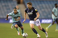Millwall midfielder George Evans  (28)  and Leicester City Midfielder Youri Tielemans (8) battles for possession during the EFL Cup match between Millwall and Leicester City at The Den, London, England on 22 September 2021.