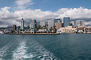 A view of downtown Honolulu, Hawaii from a boat leaving the harbor.