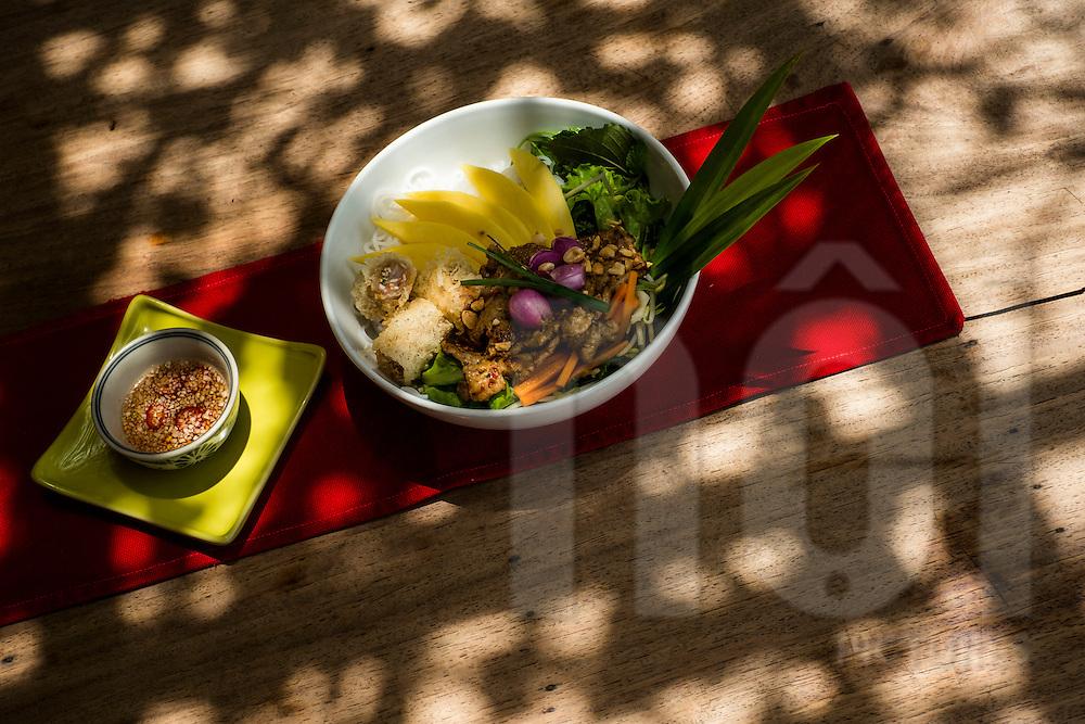 A bowl of bun thit nuong xoai (pork noodles with mango) at Mango Mango restaurant in Hoi An, Vietnam, Southeast Asia