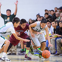 020715       Cable Hoover<br /> <br /> Thoreau Hawks Nathan Francisco (32) and Alfred Smith (21) and Shiprock Chieftain Rookie Hoskie (3) chase down a loose ball Saturday at Thoreay High School.
