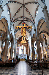 THEMENBILD - Die Basilika Santa Maria Novella ist eine gotische Kirche und Klosteranlage in Florenz. Sie liegt im Nordwesten der Altstadt, an der Piazza Santa Maria Novella, fast unmittelbar neben dem nach ihr benannten Hauptbahnhof. Hier im Bild Kruzifix von Giotto di Bondone (ca. 1280). Aufgenommen am 18. Oktober 2015 // Santa Maria Novella is a church in Florence, Italy, situated just across from the main railway station which shares its name. Chronologically, it is the first great basilica in Florence, and is the city's principal Dominican church. The church, the adjoining cloister, and chapterhouse contain a store of art treasures and funerary monuments. Especially famous are frescoes by masters of Gothic and early Renaissance. They were financed through the generosity of the most important Florentine families, who ensured themselves of funerary chapels on consecrated ground. Pictured on 18. October 2015. EXPA Pictures © 2015, PhotoCredit: EXPA/ Johann Groder