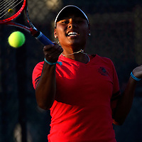 050814       Adron Gardner<br /> <br /> Grants Pirate Paris Corley hits to number two ranked Albuquerque Academy Charger Dani Apodaca for the 4A girls state tennis championship at the Jerry Cline Tennis Complex in Albuquerque Thursday.