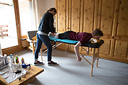 Freestyle snowboarder Matt McCormick undergoing routine physiotherapy with Lisa Filzmoser on 07th May 2017 in Corvatsch, Switzerland. Piz Corvatsch is a mountain in the Bernina Range of the Alps, overlooking Lake Sils and Lake Silvaplana in the Engadin region of the canton of Graubünden.