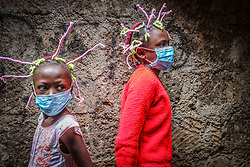 May 9, 2020, Nairobi, Kenya: 12 year old Martha Apisa (Right) and her close neighbor 8 year old Stacy Ayuma (Left), are seen using their hair style braids to create awareness and sensation about the Corona Virus during the pandemic..Kenya has recorded 649 confirmed cases, 207 recovered and 30 deaths to the covid 19 disease. (Credit Image: © Donwilson Odhiambo/SOPA Images via ZUMA Wire)
