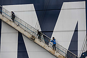 Crew members board the CMA CGM SAs Benjamin Franklin container ship as it is docked at Guangzhou Nansha Container Port in Guangzhou, China, on Monday, Feb. 1, 2016. The Benjamin Franklin is the largest container ship ever to have docked at a U.S. port.