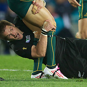 Richie McCaw, New Zealand, make a tackle during the New Zealand V Australia Semi Final match at the IRB Rugby World Cup tournament, Eden Park, Auckland, New Zealand, 16th October 2011. Photo Tim Clayton...