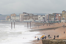 © Licensed to London News Pictures. 11/11/2017. Brighton, UK. Members of the public brave the cold and wet weather to spend the day on the beach in Brighton and Hove, Today 11th November 2017. Photo credit: Hugo Michiels/LNP