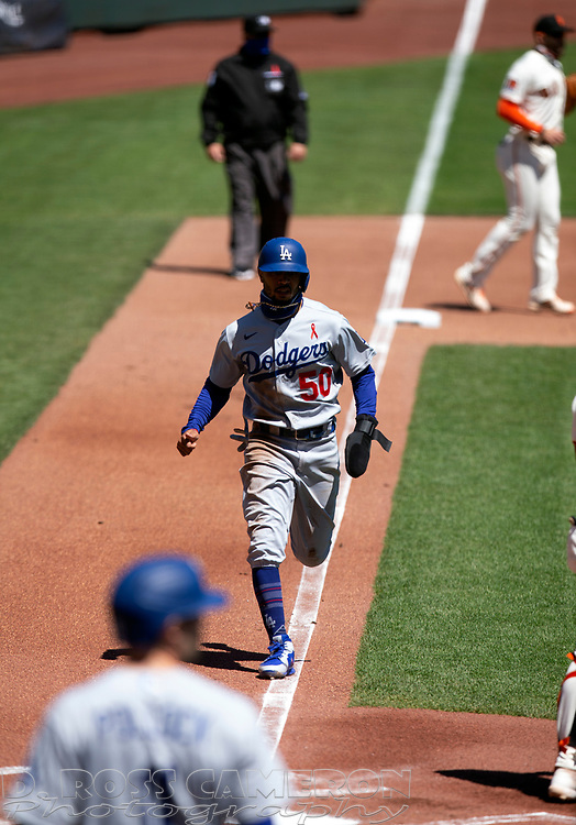 Los Angeles Dodgers right fielder Mookie Betts (50) scores his team's first run on a Clay Bellinger groundout against the San Francisco Giants during the first inning of a baseball game on Thursday, Aug. 27, 2020 in San Francisco, Calif. (D. Ross Cameron/SF Chronicle)