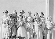 0003-058. Elementary school girl's softball team, Evaline school, near Winlock, Washington. The photographer, Stuart Fresk, was a teacher there from 1935 to 1946.
