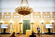 """DEN HAAG, 13-10-2020, Paleis Noordeinde<br /> <br /> Koningin Maxima ontvangt in bijzijn van Zijne Majesteit de Koning op Paleis Noordeinde een kleine groep betrokken bij het pact 'Naar een schuldenzorgvrij Nederland'. De bijeenkomst, die oorspronkelijk gepland stond voor 18 maart, was voor andere genodigden te volgen als webinar. Koningin Máxima hield een toespraak, evenals staatssecretaris Bas van 't Wout van Sociale Zaken en Werkgelegenheid en de voorzitter van SchuldenLabNL, Gerrit Zalm.  <br /> <br /> In the presence of His Majesty the King, Queen Maxima will receive a small group involved in the pact """"Towards a debt-free Netherlands"""" at Noordeinde Palace. The meeting, which was originally scheduled for March 18, could be followed by other guests as a webinar. Queen Máxima gave a speech, as well as State Secretary Bas van 't Wout of Social Affairs and Employment and the chairman of SchuldenLabNL, Gerrit Zalm."""