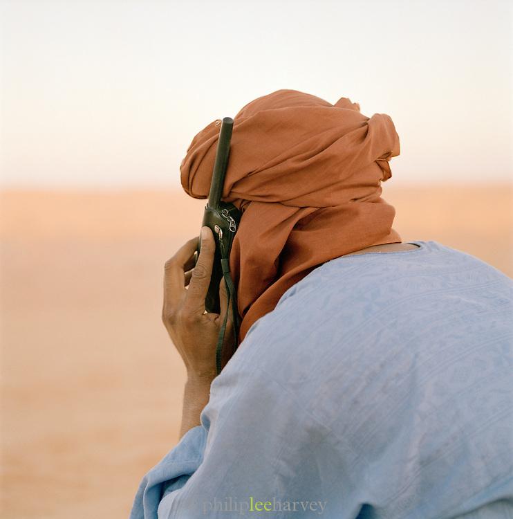 Tuareg Desert Guide using satellite telephone, Sahara Desert, Libya