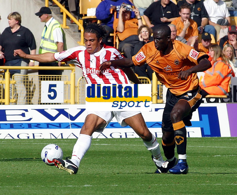 Photo: Dave Linney.<br />Wolverhampton Wanderers v Stoke City. Coca Cola Championship. 23/09/2006Wolve's. Seyi  Olofinjana(R) keeps a check on Darel Russell
