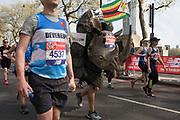 Participant wearing a rhino costume from Save The Rhino, taking part in the London Marathon on 22nd April 2018 in London, England, United Kingdom. The London Marathon, presently known through sponsorship as the Virgin Money London Marathon, is a long-distance running event. The event was first run in 1981 and has been held in the spring of every year since. The race is mainly known for ebing a public race where ordinary people can challenge themsleves while raising great amounts of money for various charities.