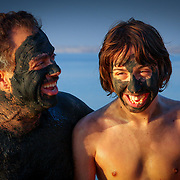 Mud-covered father and son at Dead Sea, Jordan (December 2007)