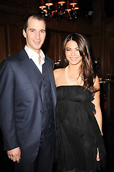 The HON.WILLIAM ASTOR and his wife LOHRALEE at the Tatler Little Black Book Party held at Tramp, 40 Jermyn Street, London on 3rd November 2010.