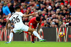 Kyle Naughton of Swansea City tackles Philippe Coutinho of Liverpool - Mandatory by-line: Matt McNulty/JMP - 21/01/2017 - FOOTBALL - Anfield - Liverpool, England - Liverpool v Swansea City - Premier League