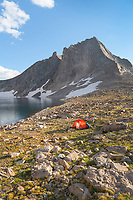 Noel Lake backcountry camp with red tent. Nylonn Peak is in the background. Bridger Wilderness. Wind River Range, Wyoming