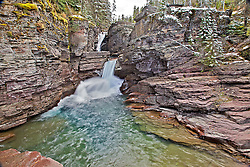 St. Mary Falls with new snowy accents in Autumn at Glacier National Park