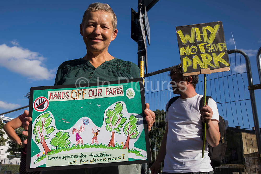 Southwark residents and campaigners protest alongside Peckham Green against plans by Southwark Council to develop it as public housing on 14th August 2021 in London, United Kingdom. Peckham Green, also known as Jocelyn Street Park, is a 1.4-acre public park off Peckham High Street, one of the most polluted roads in London, in a borough which is ranked fifth-worst in London and eighth-worst in the UK for easy access to green space.