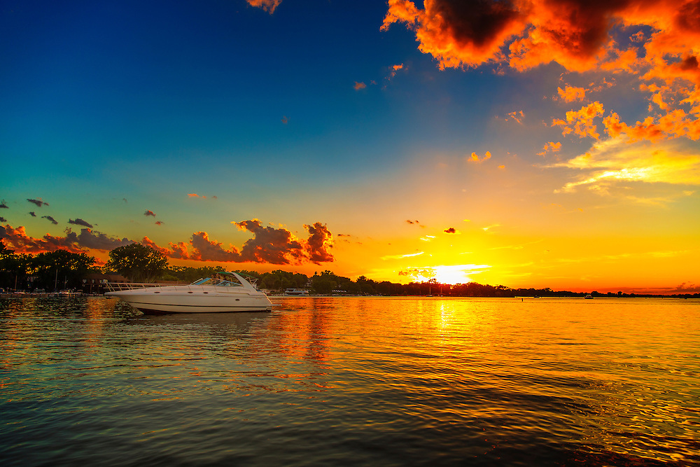 Boating under a warm setting sun, with a cool breeze on a lovely day. What could be better?