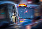London taxi at dusk in busy london street